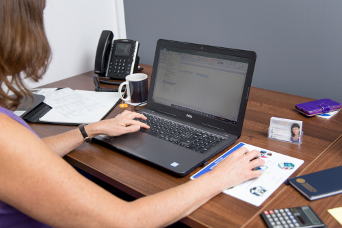 Woman working on a laptop at her desk